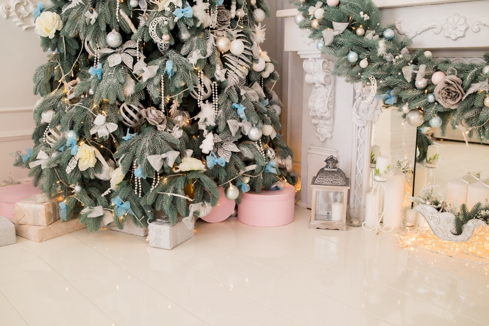 gray candle lantern beside Christmas tree