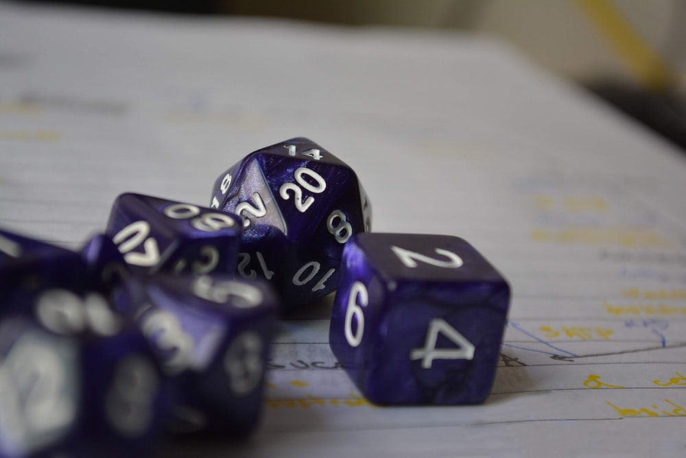 purple-and-white dices on white lined paper
