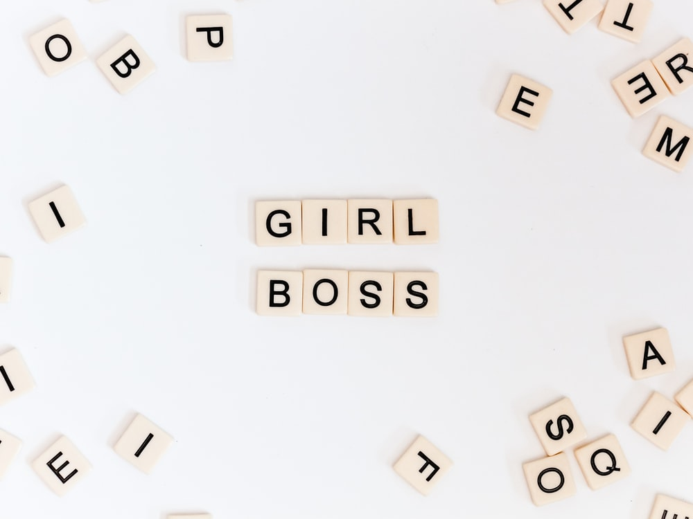 girl boss text on brown background