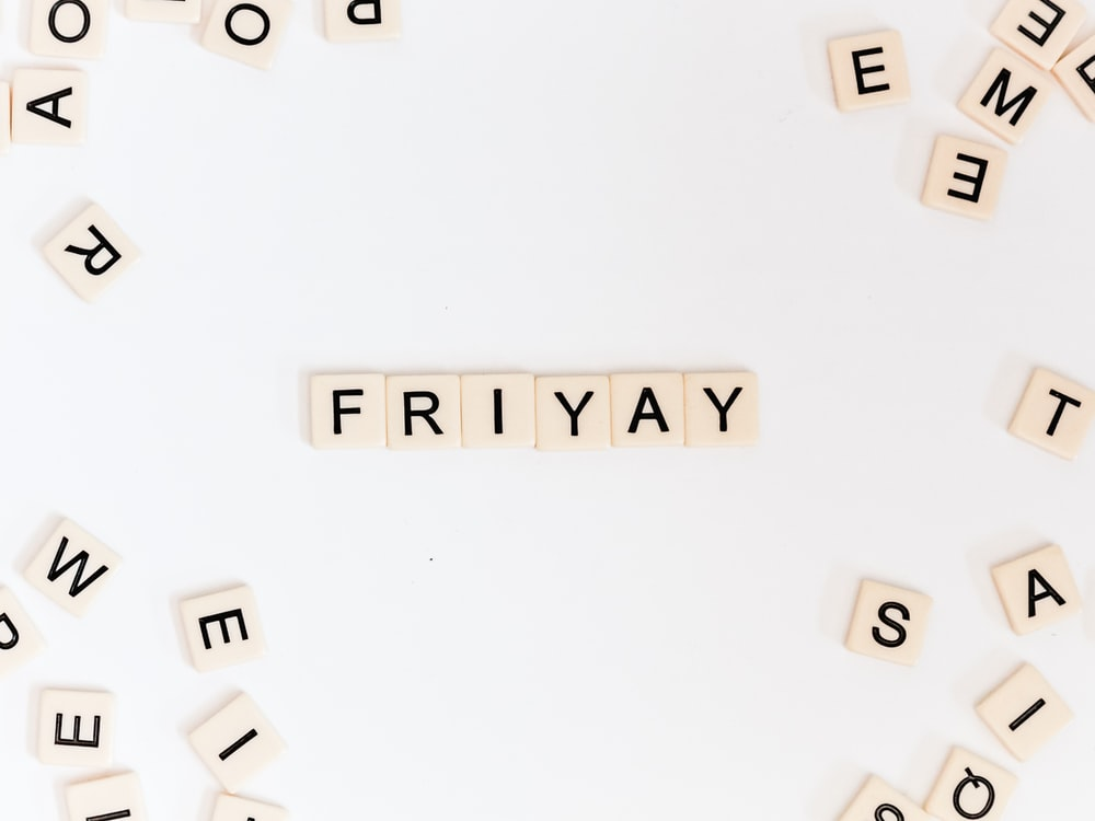 Friyay scrabble pieces on white surface