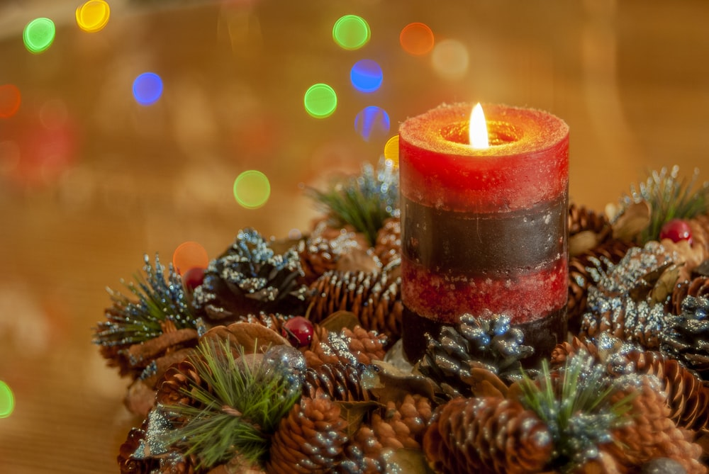 lighted Christmas red candle