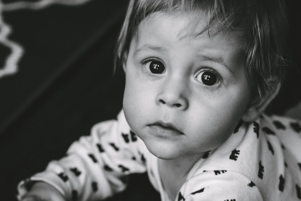 grayscale photo of baby