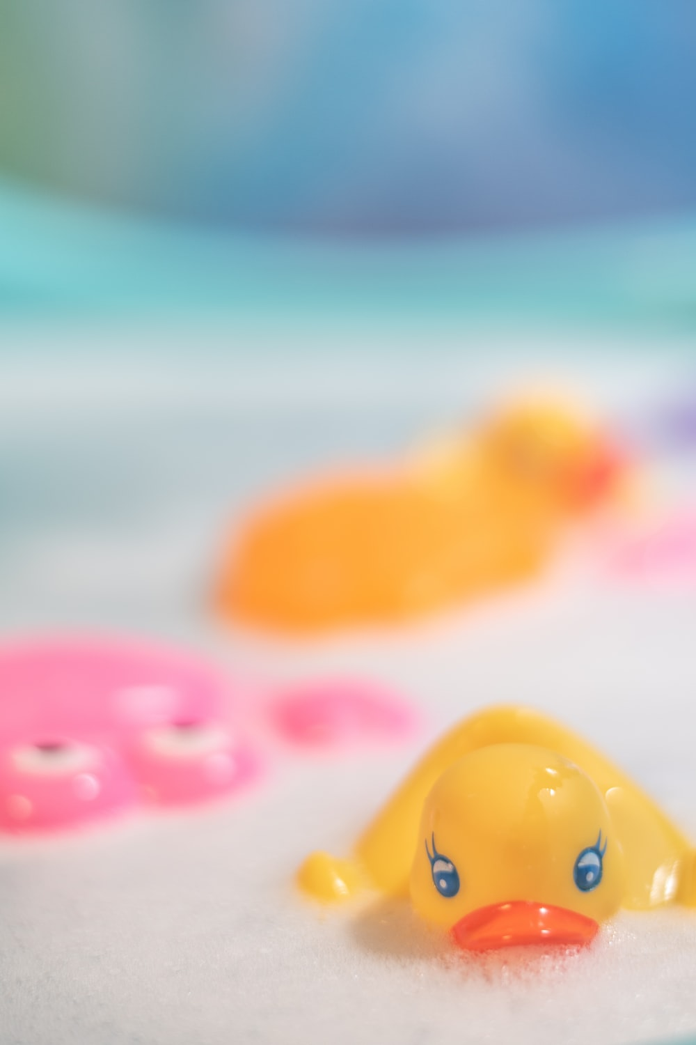 yellow and pink plastic toys