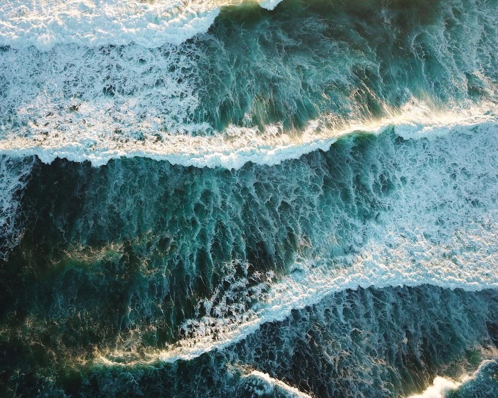 waves crashing through shores