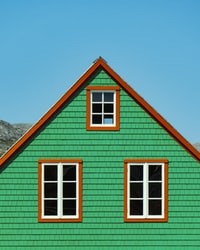 green and brown wooden house