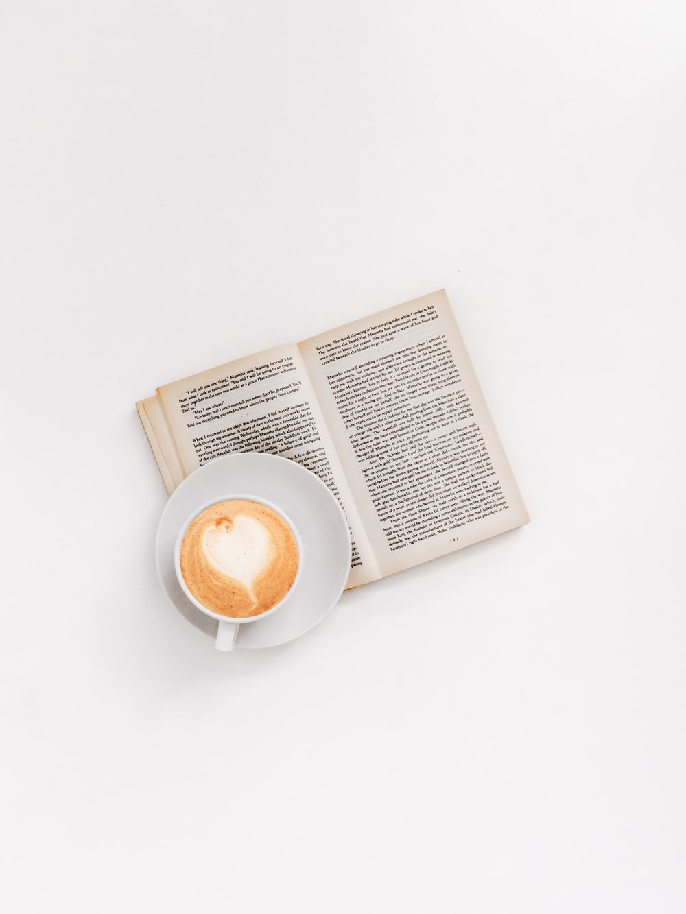 cappuccino on brown book
