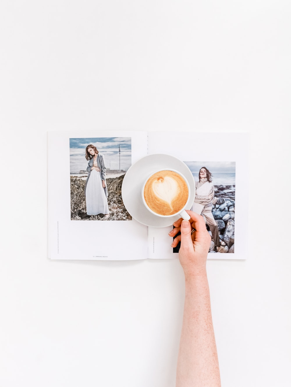 person holding cup of coffee