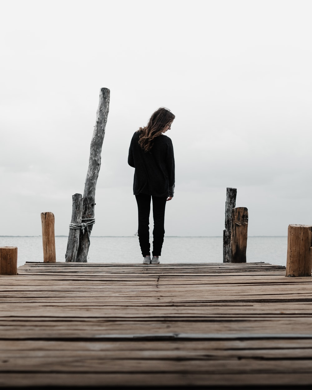 woman standing on wooden dock