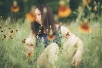 woman sitting on grasses