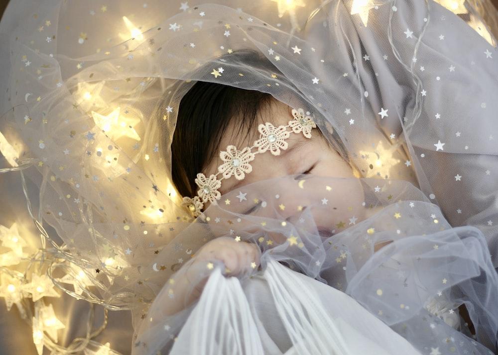 baby wearing veil