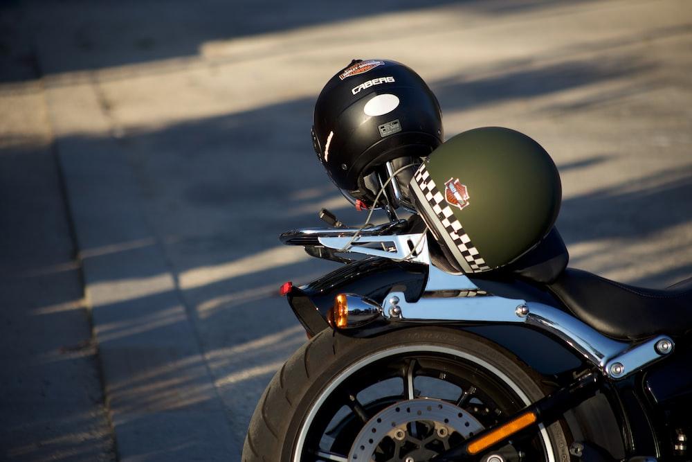 green and black helmet on motorcycle