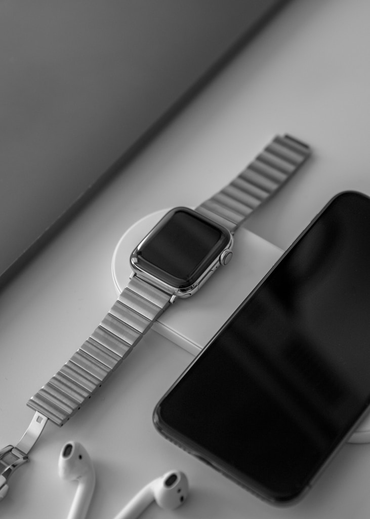 space gray Apple Watch beside space gray iPhone X