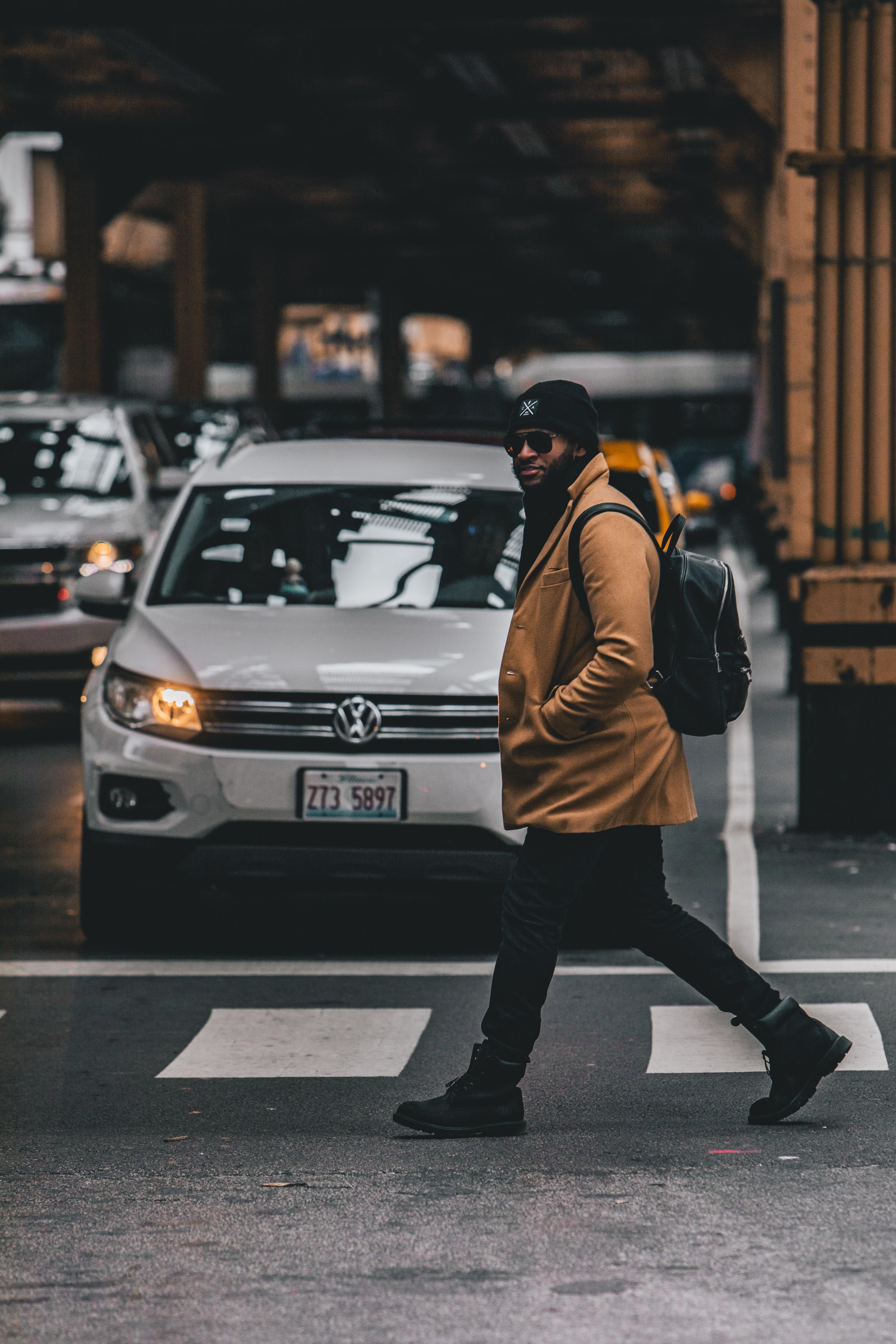 man crossing streets
