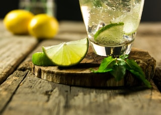 lime beverage on wooden board