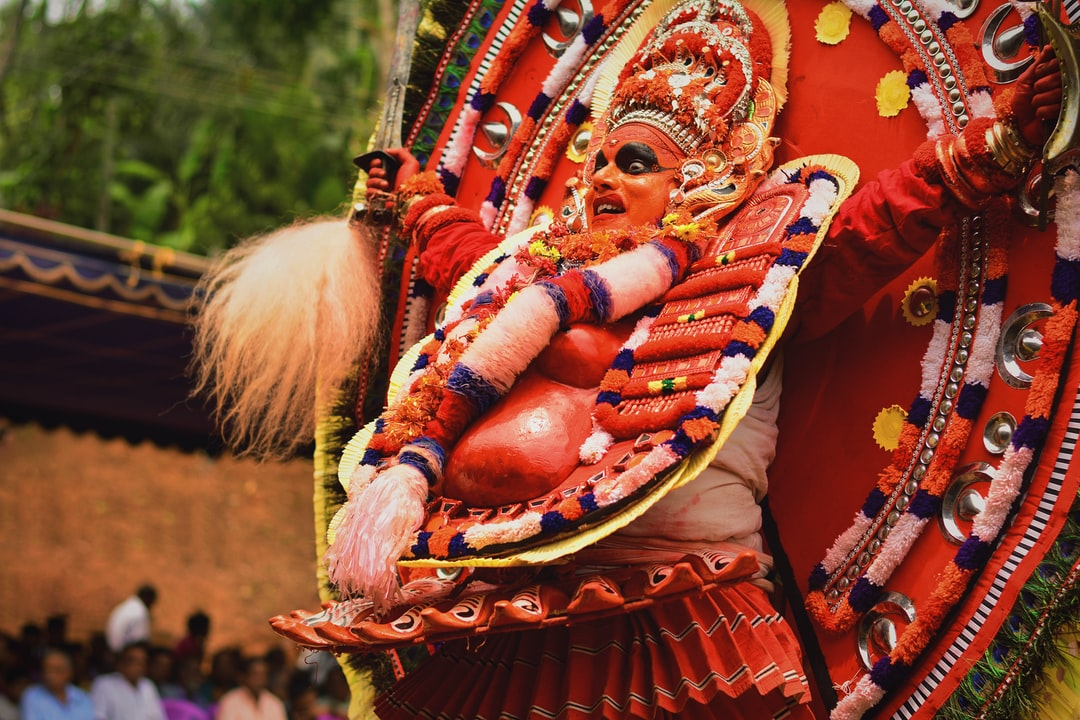 Theyyam is a ritual form in Kerala, India. If you have ever had a chance to see this ritual, you will know that the person performing the Theyyam is considered as the supreme power while in that state. This particular Theyyam is a 'Chaamundi', a fearsome aspect of Devi, one of the seven Matrikas (mother goddesses) in Hindu mythology. This was one of 39 Theyyam that took place at my native place spanning for a period of 3 days. This still perfectly portrays the spine-chilling energy of the epitome while he performs the ritual with sheer faith and zeal.