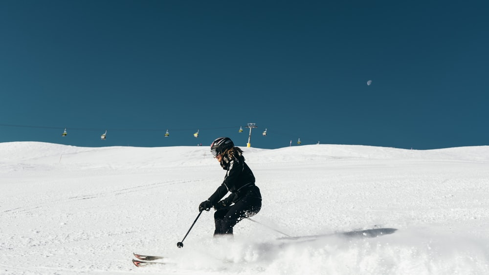 person skiing on ice field