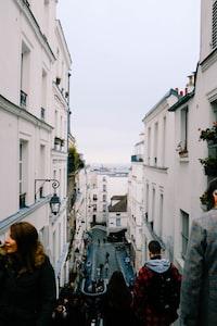 people walking near white houses