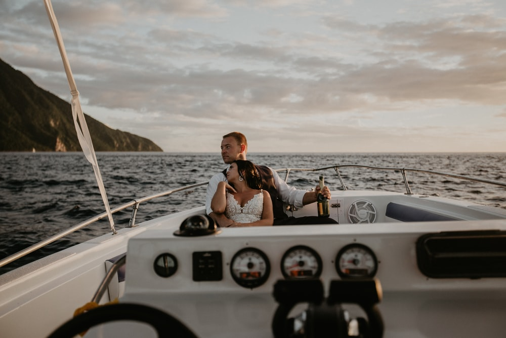 couple sailing on boat during daytime