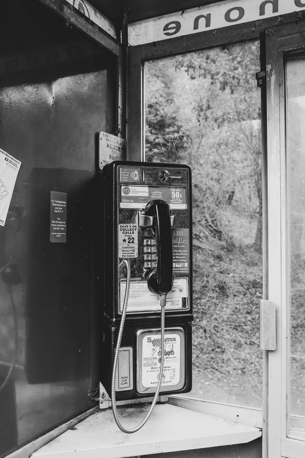 grayscale photography of telephone booth