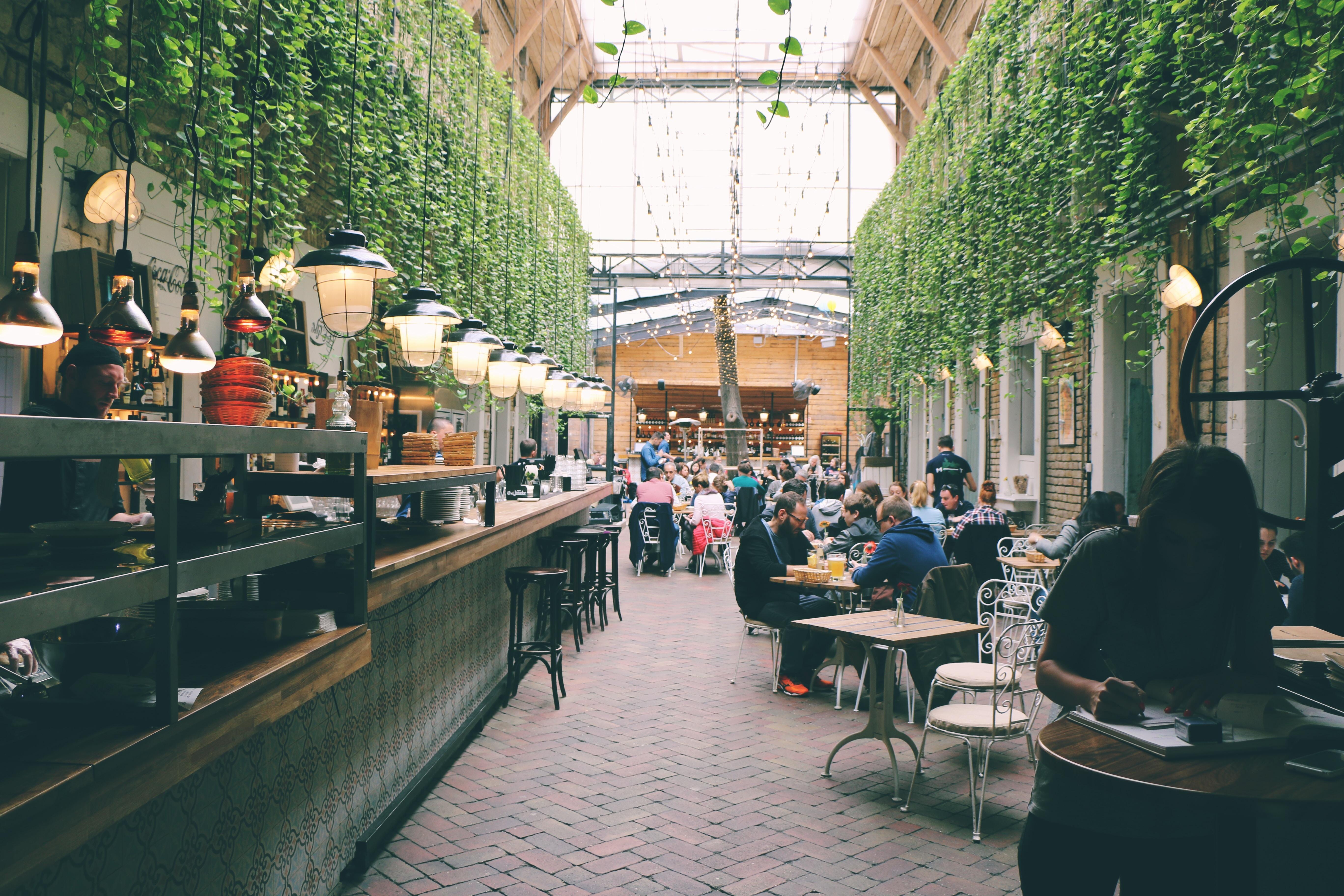 people sitting inside restaurant tables