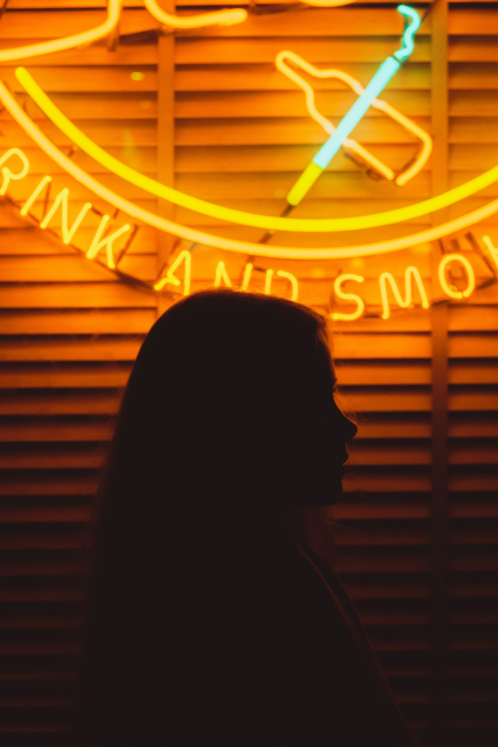 woman in front of lighted neon signage