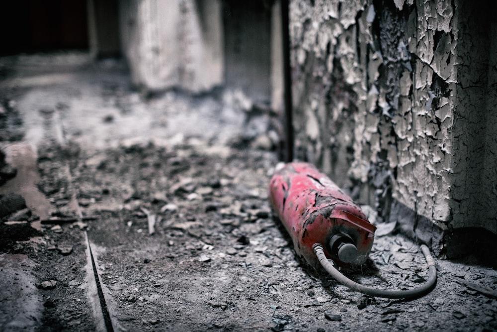 broken red fire extinguisher