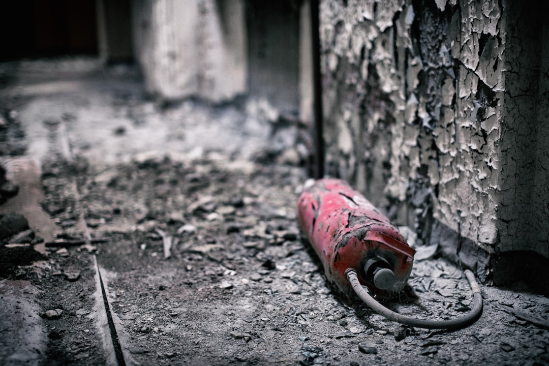A old extinguisher in a burnt room