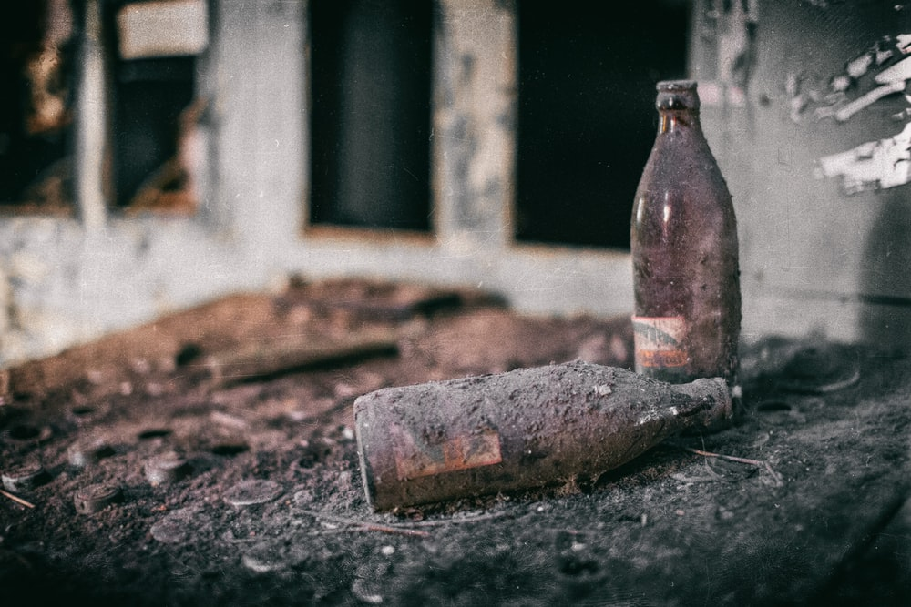 selective focus photography of two brown bottles