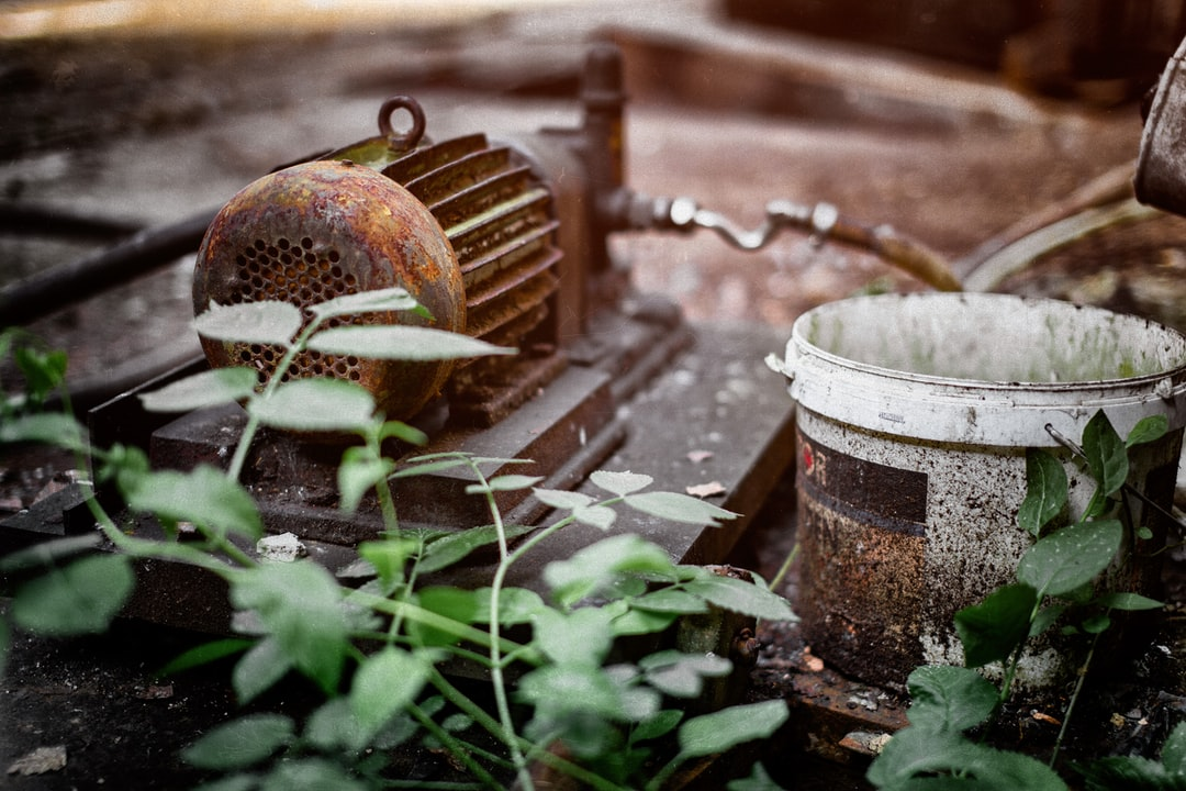 A rusted pump at a lost place
