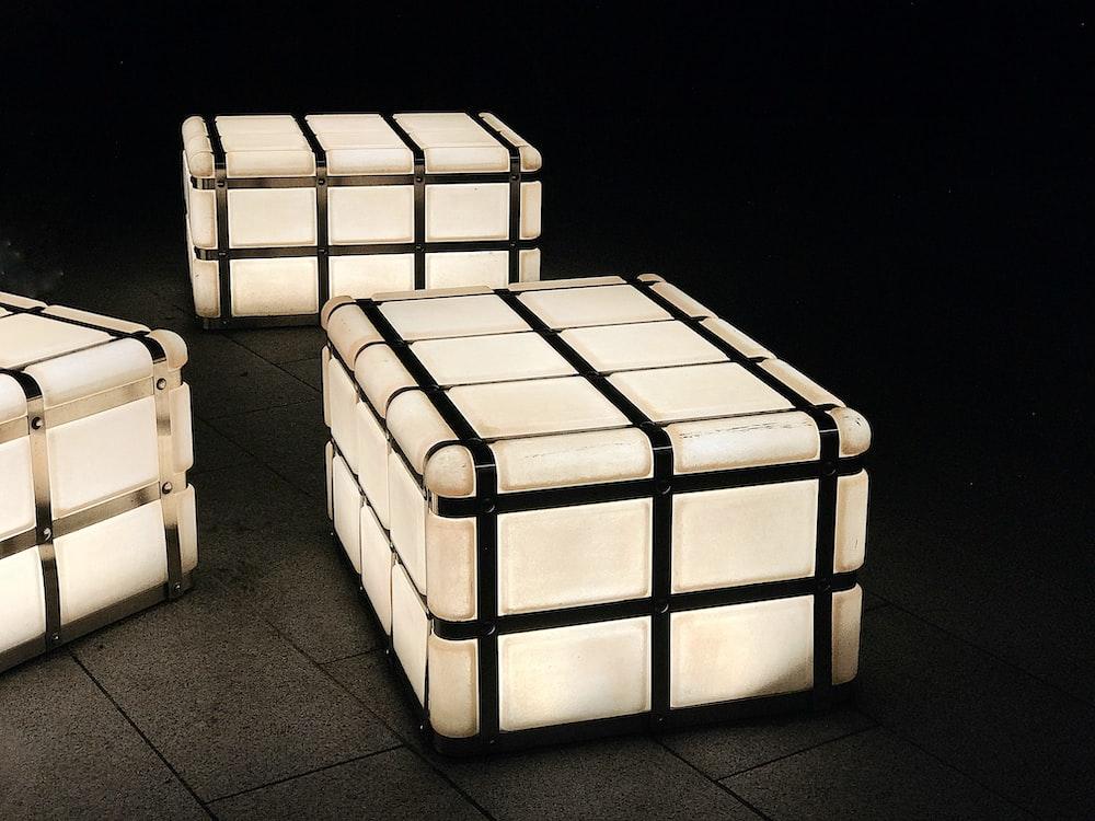 three rectangular white-ad-black cases