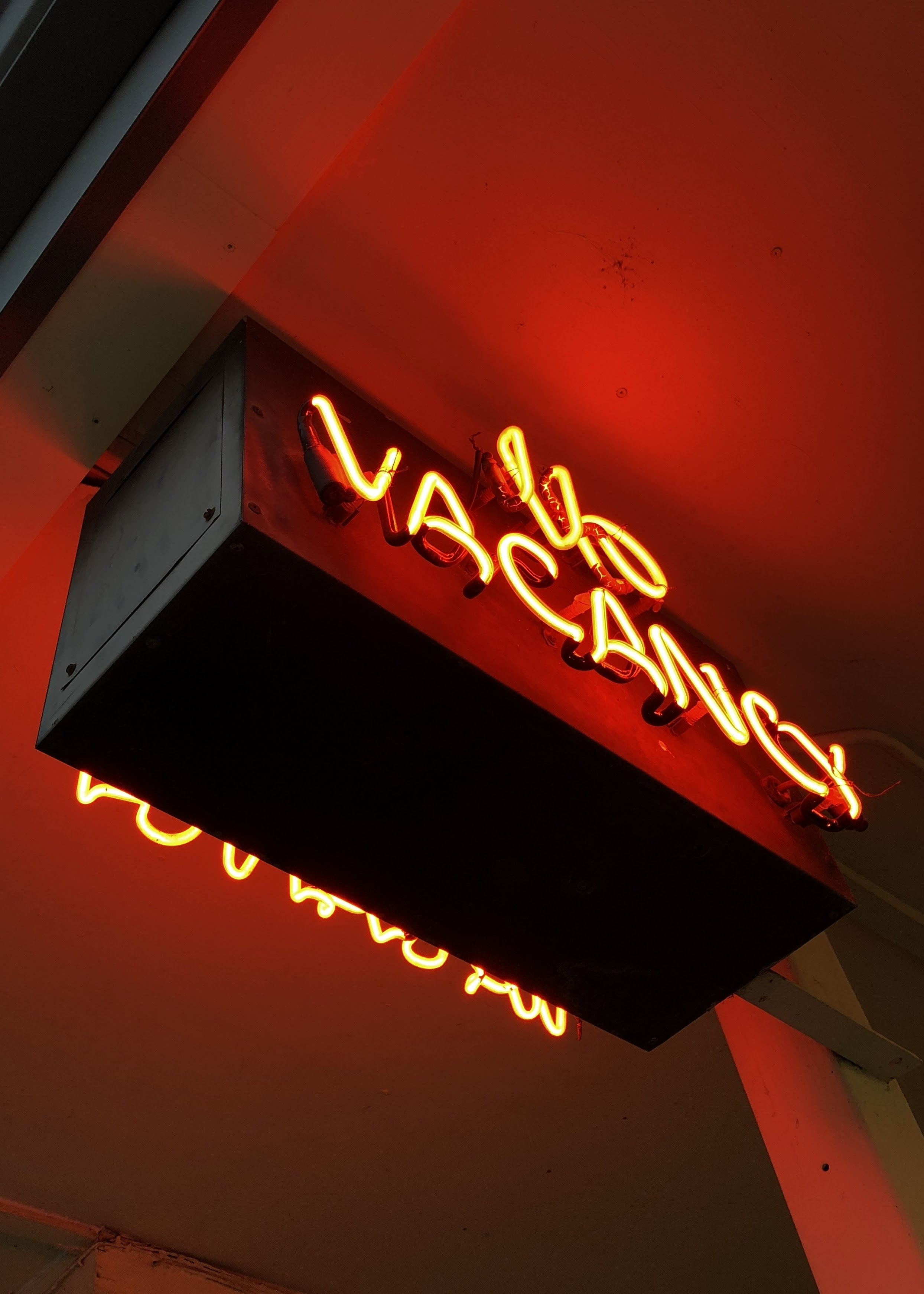 no vacancy neon light signage turned-on