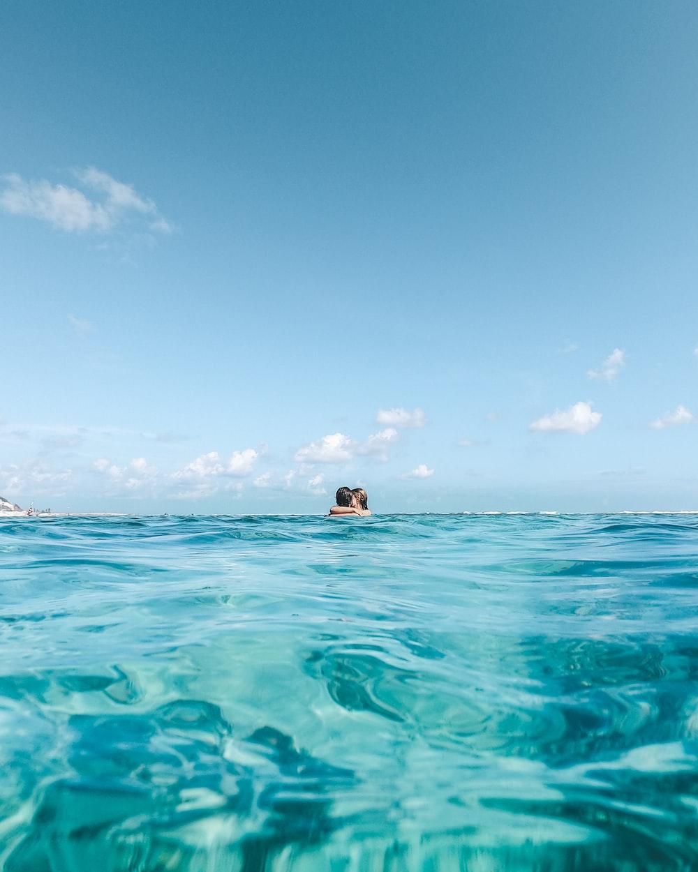 couple swimming in beach