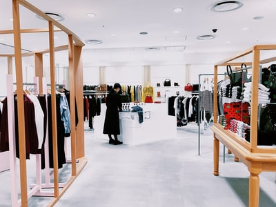 woman standing inside clothing area shop teams background