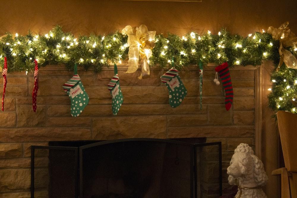 string lights with christmas socks on wall