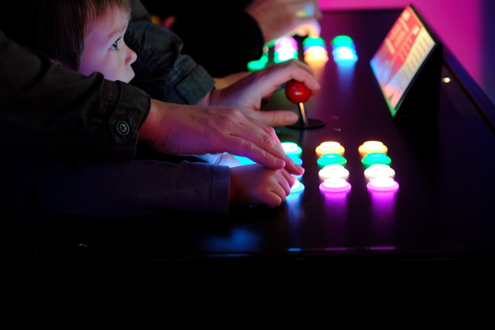 boy playing arcade cabinet