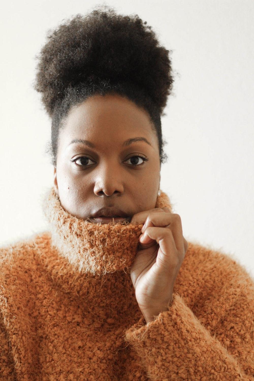 woman wearing brown turtleneck sweatshirt