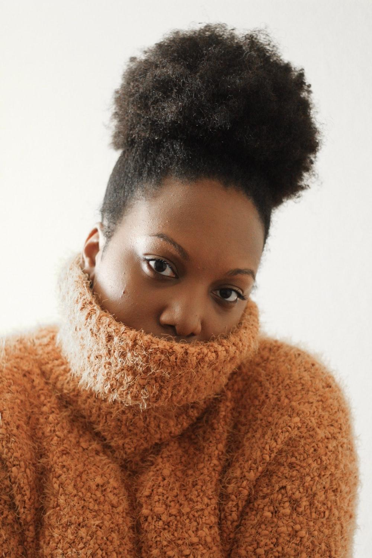 woman wearing brown turtleneck sweater