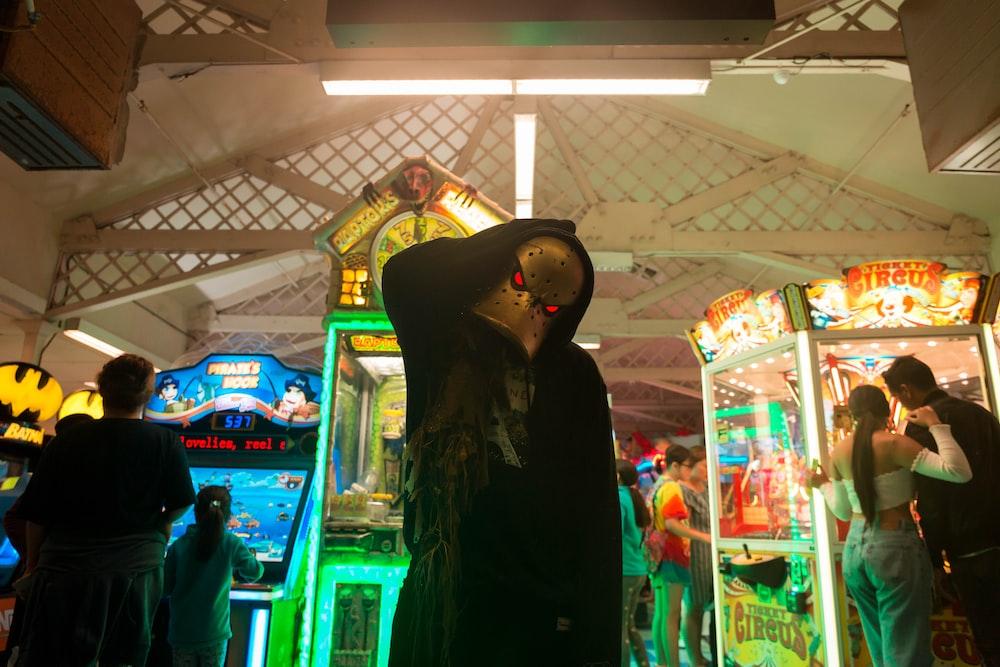 person standing near arcade machine