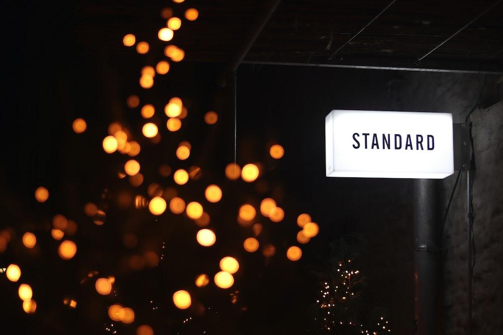 white standard LED signage mounted on wall