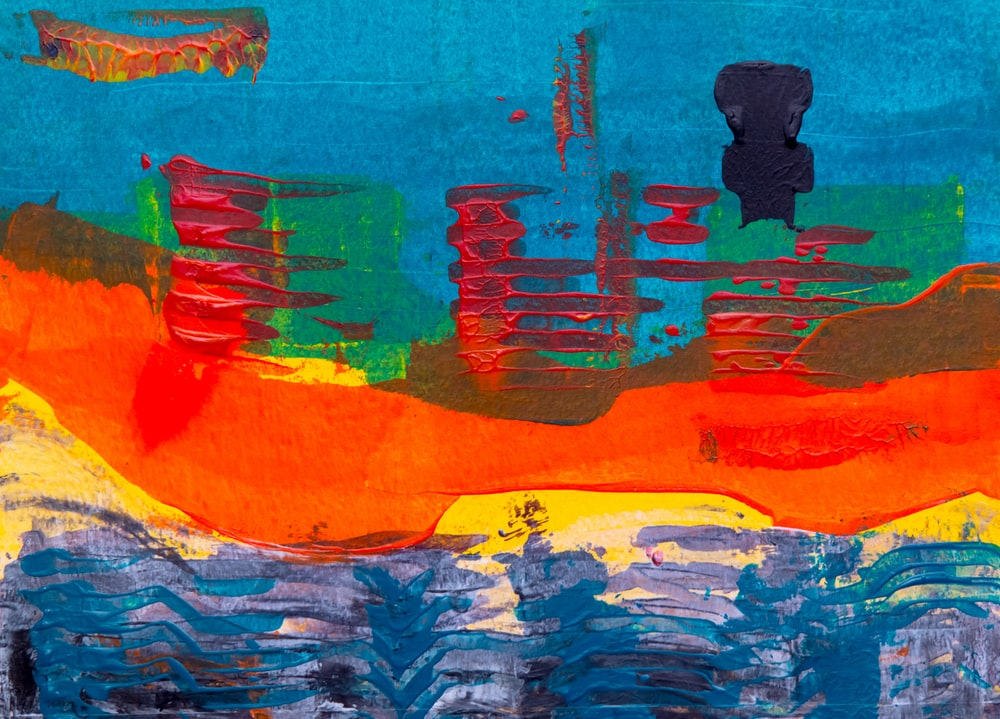 red and yellow islet and body of water painting