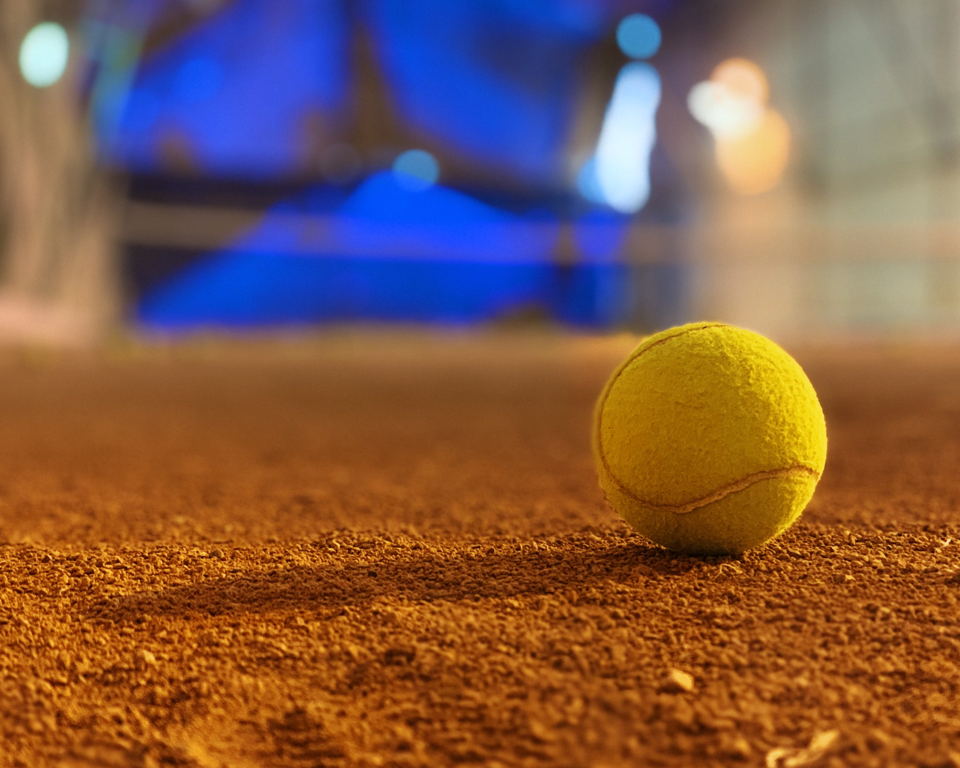 selective focus photography of tennis ball
