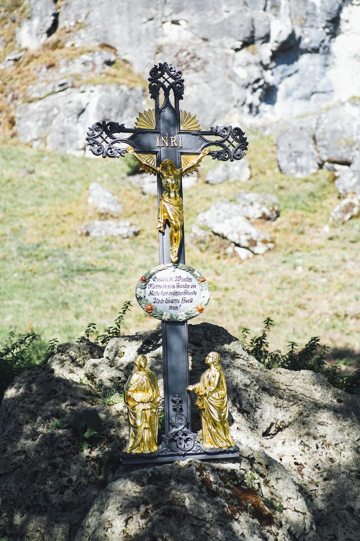 shallow focus photo of crucifix figurine