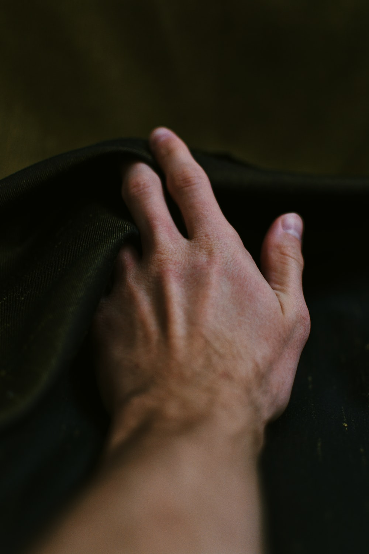 person holding black textile