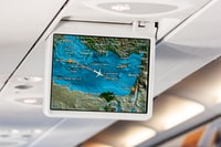 flat screen monitor displaying airplane route