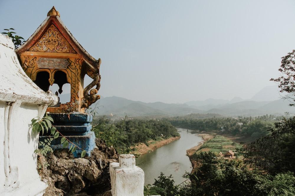 brown temple near river