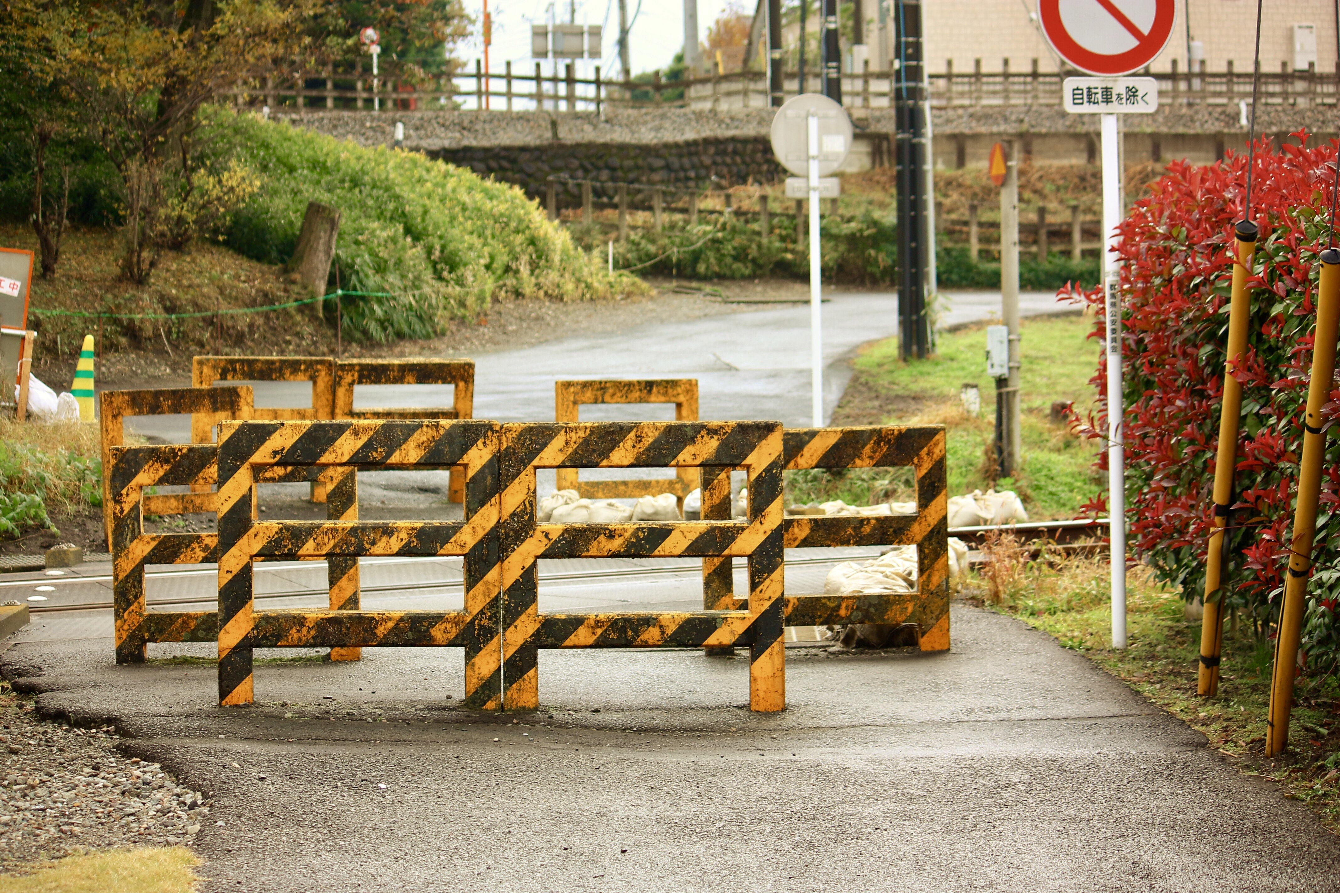 yellow-and-black wooden road barricades