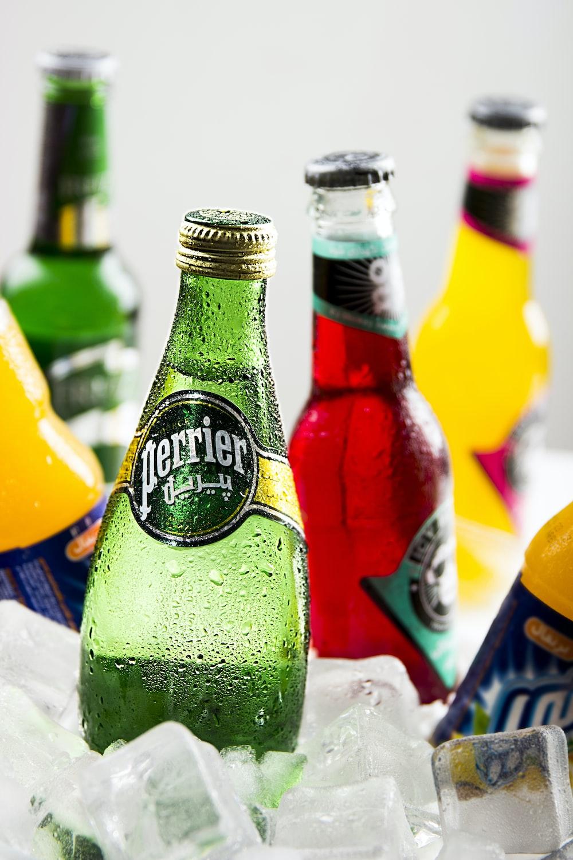 several Perrier glass drink bottles