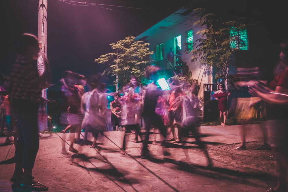 people dancing on crown during night time