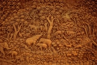 bas-relief sculpture of animals in the woods