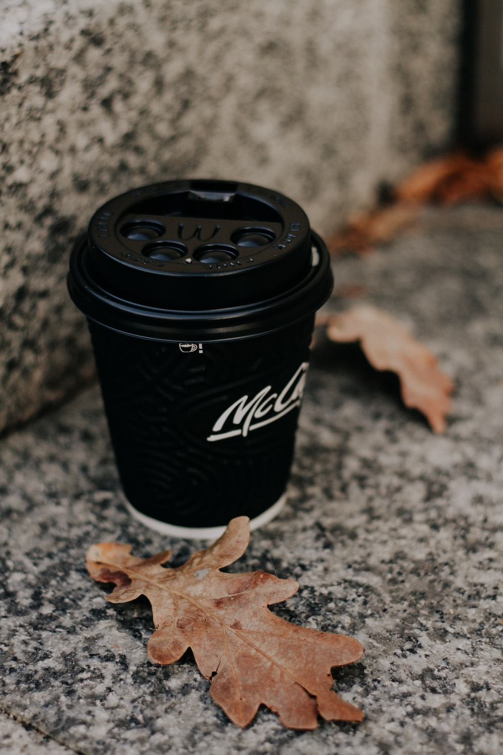black and white Mccafe disposable cup